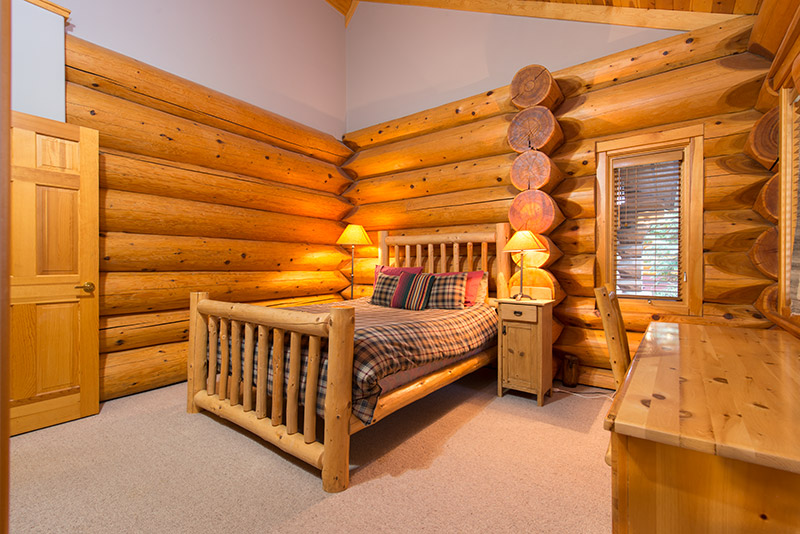 Master log bedroom with king size log bed and ensuite bathroom