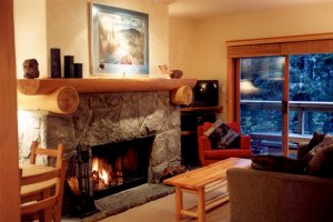 Wood-burning fireplace with log accents for crackling mid-winter fires