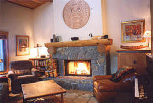 Comfy living room with Native Indian art and wood-burning fireplace for crackling mid-winter fires