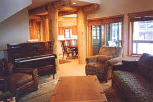 Piano and leather furnishings to round out the holiday lodging scene